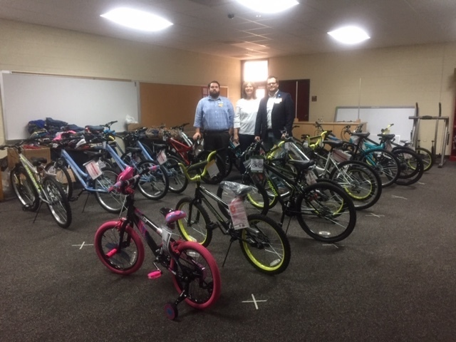 District Attorney Lisa Z and Walmart representatives with 21 bikes.