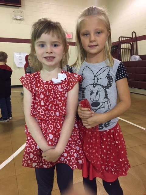 Kindergartner girls dressed in red